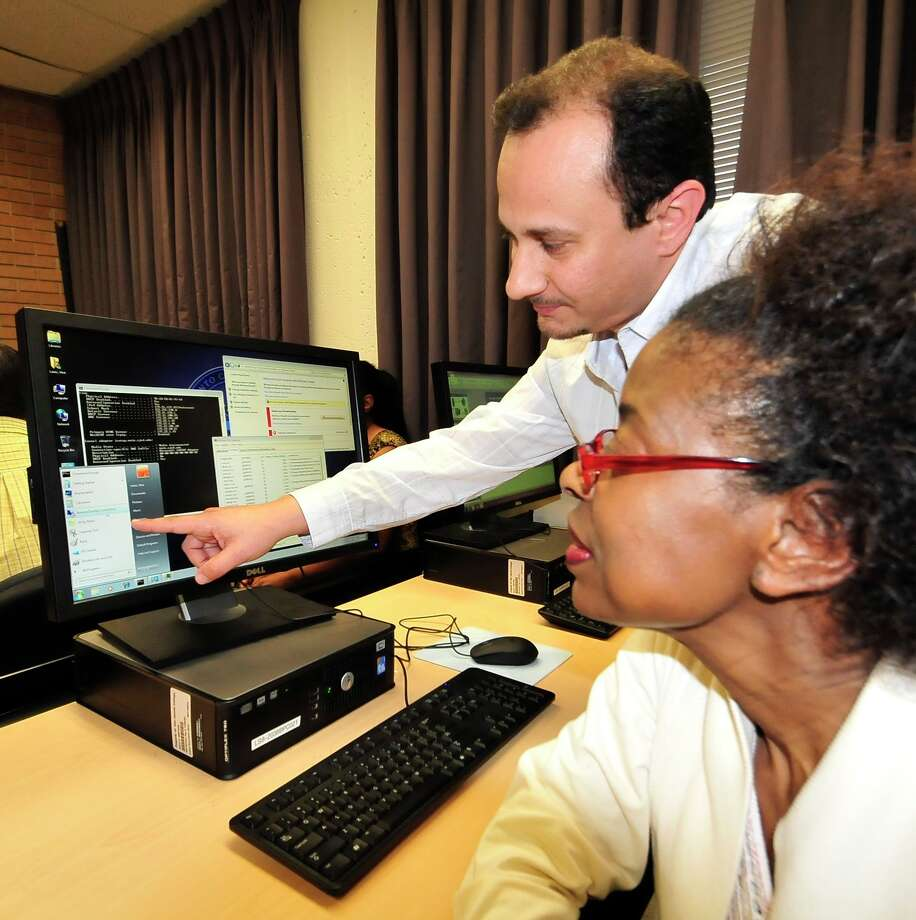 San Jacinto College features IT cybersecurity classes that are funded by the Information Technology Training for Tomorrow (IT3) grant. Raed Naser teaches student Vera Lewis in one of these classes.