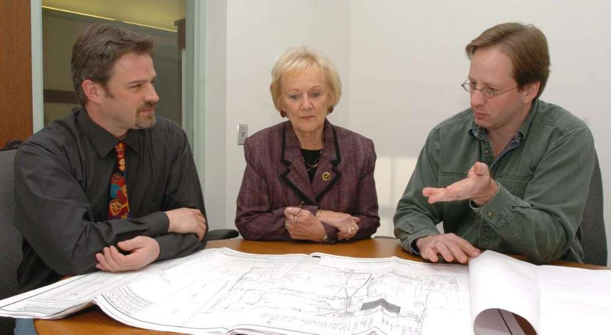 From left, Rob Sibley, Newtown First Selectman Patricia Llodra and Michael Breede, of Ridgefield chat about future plans for an educational and science facility for high school and college students in Newtown at the First Selectman's office in Newtown Friday, Dec 18, 2009.
