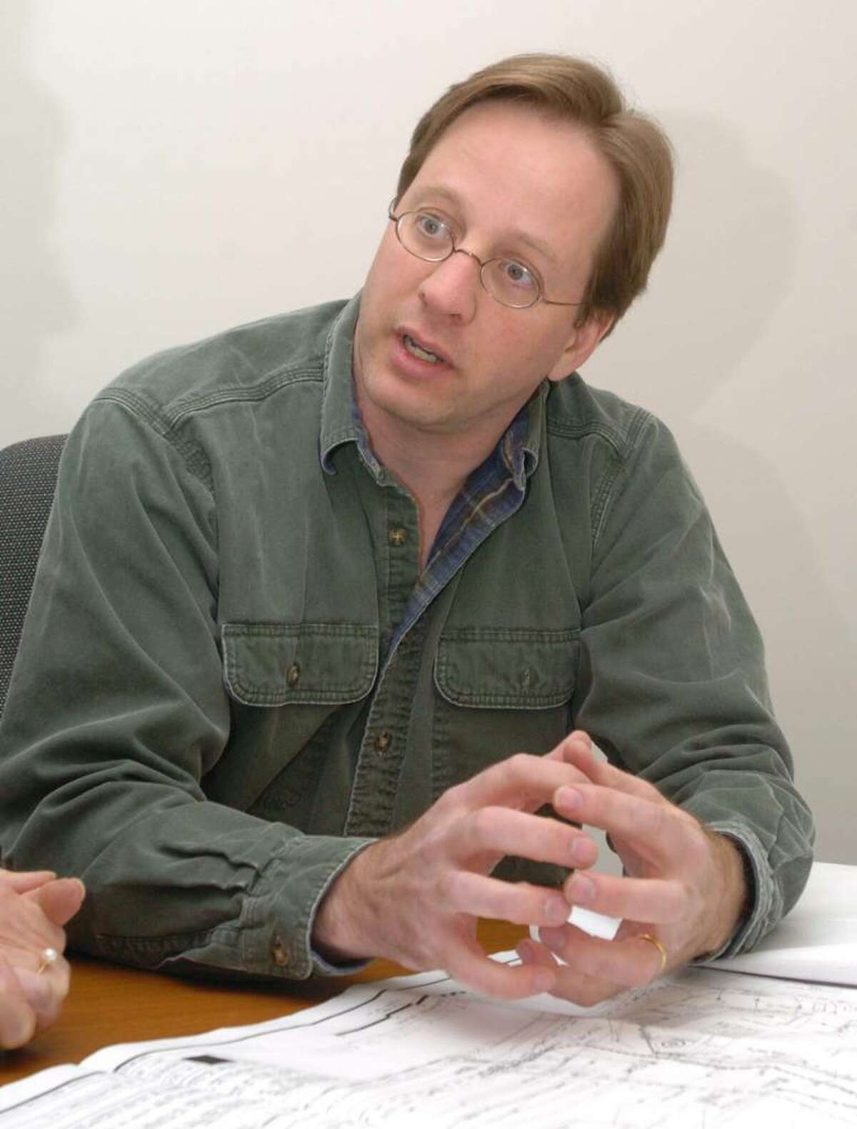 Michael Breede, of Ridgefield chats about future plans for a storm-water treatment plant in Newtown at the First Selectman's office in Newtown Friday, Dec 18, 2009.