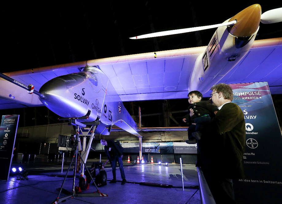 The media and officials get a closer look at the all-solar plane at Moffett Field in Mountain View, Calif. Photo: Justin Sullivan, Getty Images / 2013 Getty Images