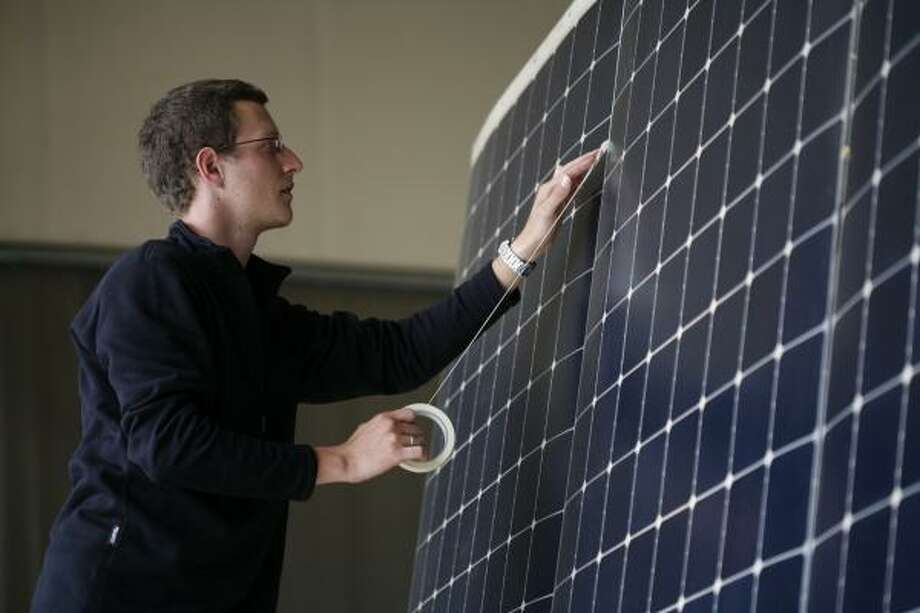 An engineer works on the solar cells for the Solar Impulse in Switzerland in 2008.