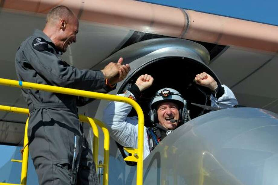 Pilot Andre Borschberg is welcomed back on the ground after a successful 26-hour non-stop flight over Switzerland in July 2010.