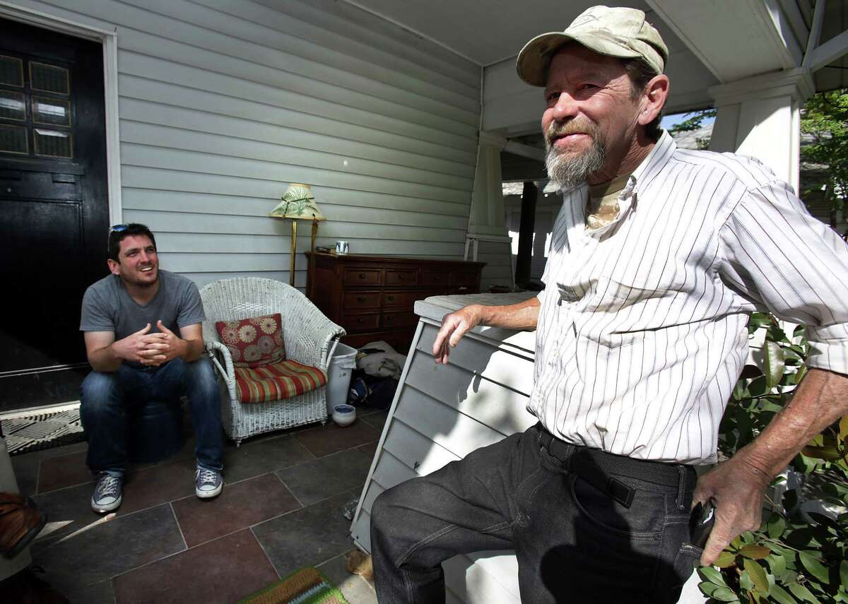 Gavin Rogers (left) sits on his front porch with Willie Schooman, who was formerly homeless.