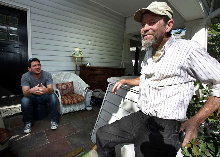 Gavin Rogers (left) sits on his front porch with Willie Schooman, who was formerly homeless. Photo: Photos By Bob Owen / San Antonio Express-News