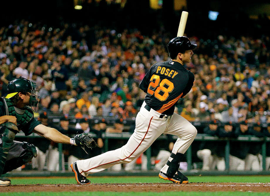 San Francisco Giants' Buster Posey (28) swings for an RBI single off Oakland Athletics' Tommy Milone in the third inning of an exhibition spring training baseball game Thursday, March 28, 2013, in San Francisco. Photo: Ben Margot, Associated Press / AP