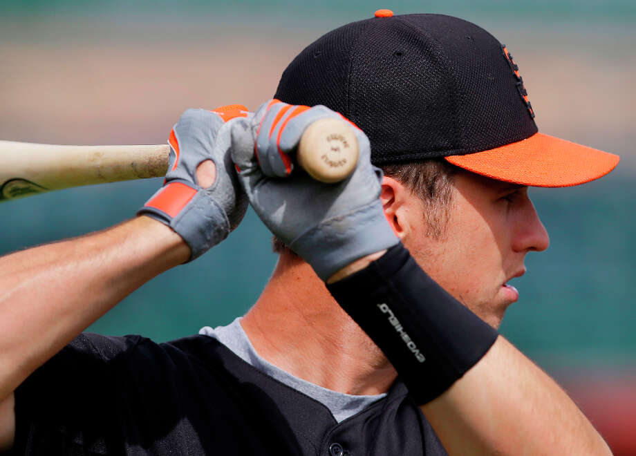San Francisco Giants' Buster Posey during batting practice before an exhibition spring training baseball game against the Milwaukee Brewers on Wednesday, March 20, 2013 in Scottsdale, Ariz. Photo: Marcio Jose Sanchez, Associated Press / AP