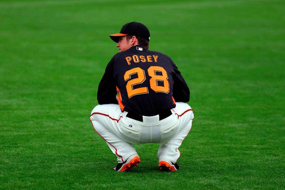 San Francisco Giants catcher Buster Posey (28) warms up before an exhibition spring training baseball game against the Arizona Diamondbacks on Sunday, March 3, 2013 in Scottsdale. Ariz. Photo: Marcio Jose Sanchez, Associated Press / AP
