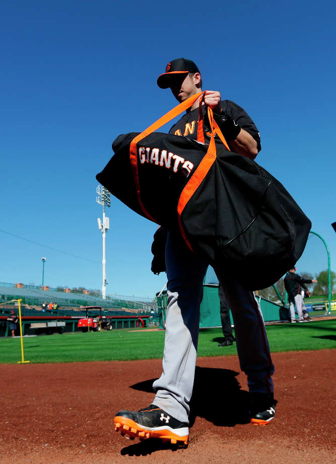 San Francisco Giants' Buster Posey walks to the dugout during a spring training baseball workout Wednesday, Feb. 13, 2013, in Scottsdale, Ariz. Photo: Darron Cummings, Associated Press / AP