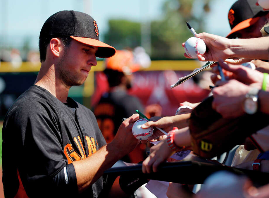 San Francisco Giants' Buster Posey signs autographs before an exhibition spring training baseball game against Japan on Thursday, March 14, 2013 in Scottsdale, Ariz. Photo: Marcio Jose Sanchez, Associated Press / AP