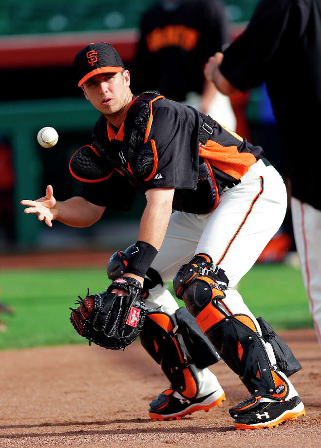 San Francisco Giants catcher Buster Posey works out before an exhibition spring training baseball game against the Colorado Rockies on Thursday, March 21, 2013 in Scottsdale, Ariz. Photo: Marcio Jose Sanchez, Associated Press / AP