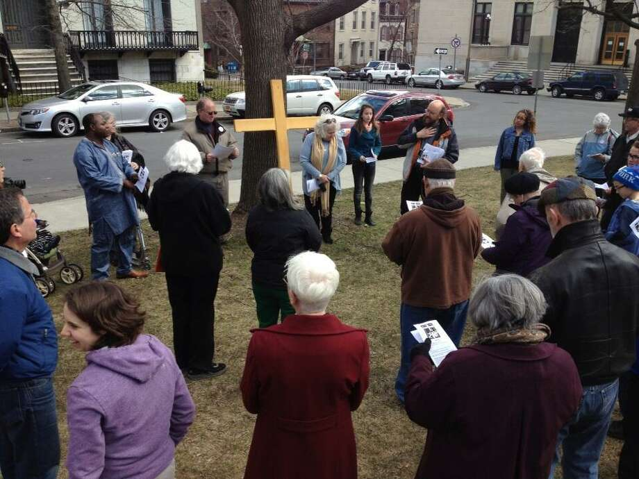 A group of Capital Region Christians observed Good Friday on March 29, 2013, with outdoor Stations of the Cross in Albany's Academy Park. (John Carl D'Annibale/Times Union)