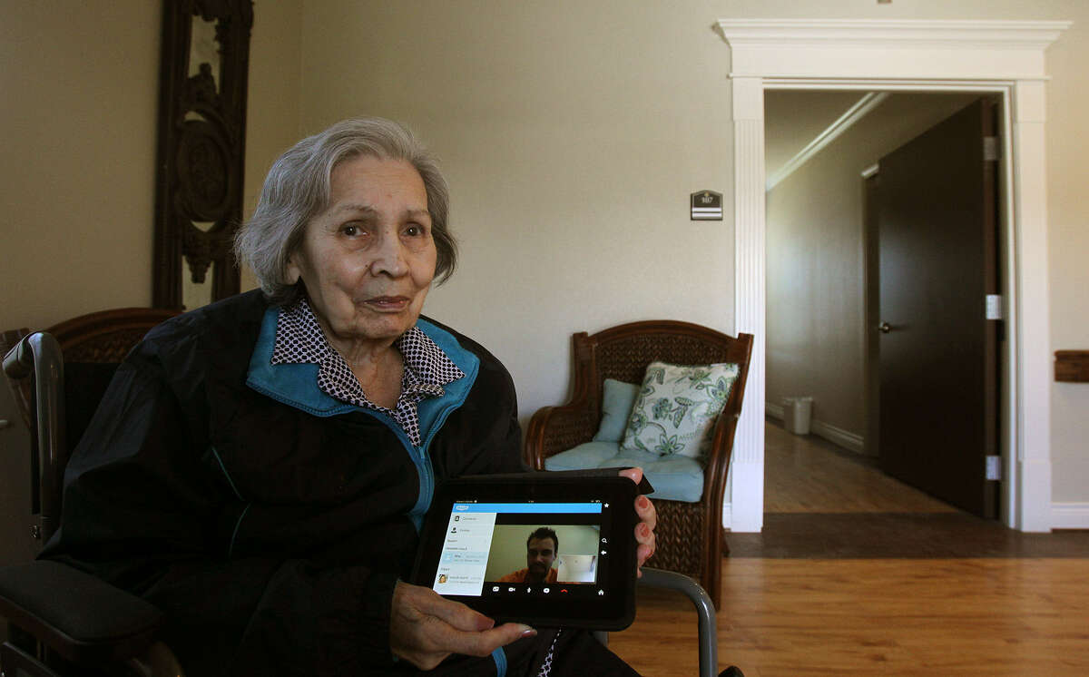 Bertha Cavazos, a resident at Las Colinas of Westover Rehabilitation, uses a Kindle Fire HD to communicate with staff and relatives who are not on the premises. The facility also has Apple TV and has digitized all of its medical records.