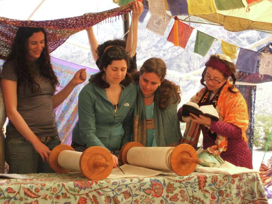 "Four women participants celebrate Torah service during their ""Passover in the Desert"" wilderness camping trip in 2011. Photo: Zelig Golden, Courtesy Photo / Religion News Service"