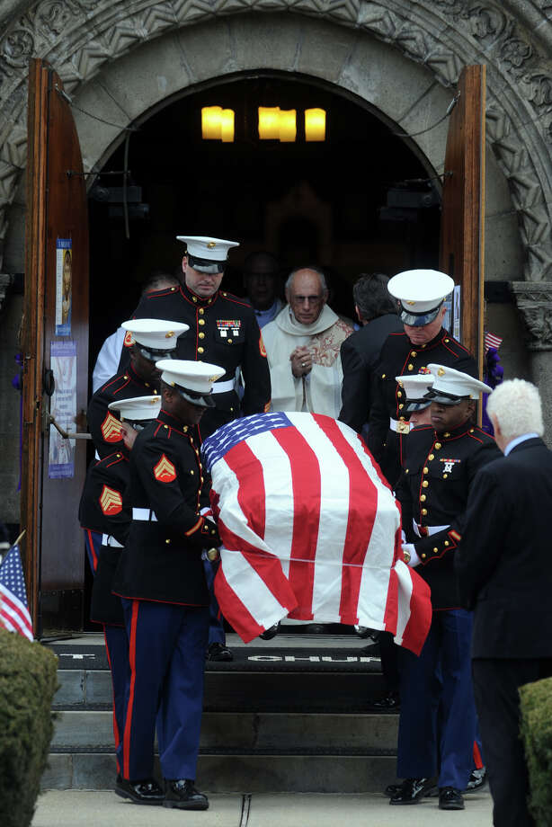 Marines carry the casket of Lance Cpl. Roger Muchnick from St. Ann's Church, in Lenox, Mass., following his funeral service March 29, 2013. Muchnick was one of seven Marines killed by an explosion during a training exercise in Nevada on March 18th. He attended Staples High School, in Westport, Conn. in 2008. Photo: Ned Gerard / Connecticut Post
