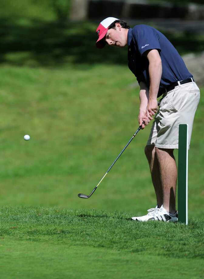 Staples' Ross Whelan hits it out of the rough on the second fairway at Longshore Golf Course in Westport  during a meet with Norwalk High School Thursday, May 10, 2012. Photo: Autumn Driscoll / Connecticut Post