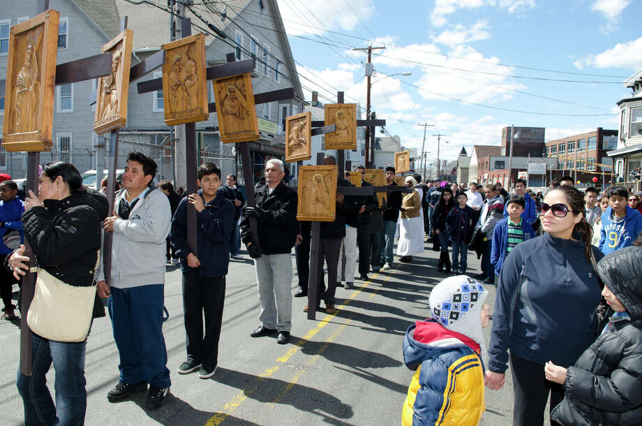 Parishioners and clergy from St. Augustine Cathedral and St. Patrick's Church fill the streets of Bridgeport during the Good Friday processional from St. Augustine's Cathedral to St. Patrick's Church in Bridgeport on Friday, Mar. 29, 2013. Photo: Amy Mortensen / Connecticut Post Freelance