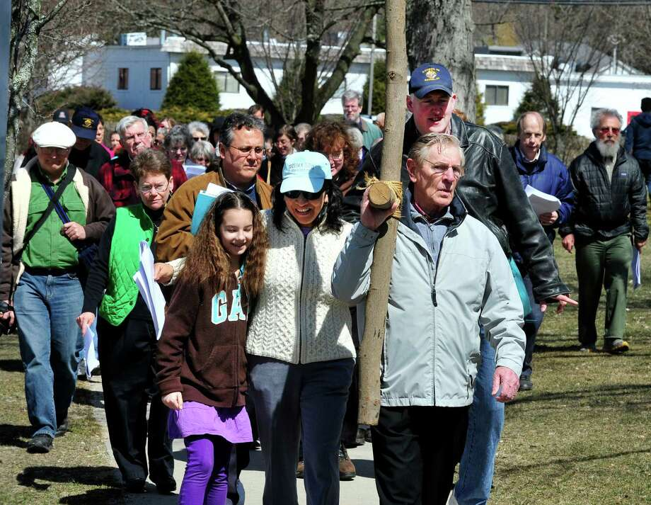 Tom Monahan carries the cross, as residents follow the stations of the cross in observance of Good Friday, during the Community Good Friday Walk in Bethel, Conn. Friday, March 29, 2013. Photo: Michael Duffy / The News-Times