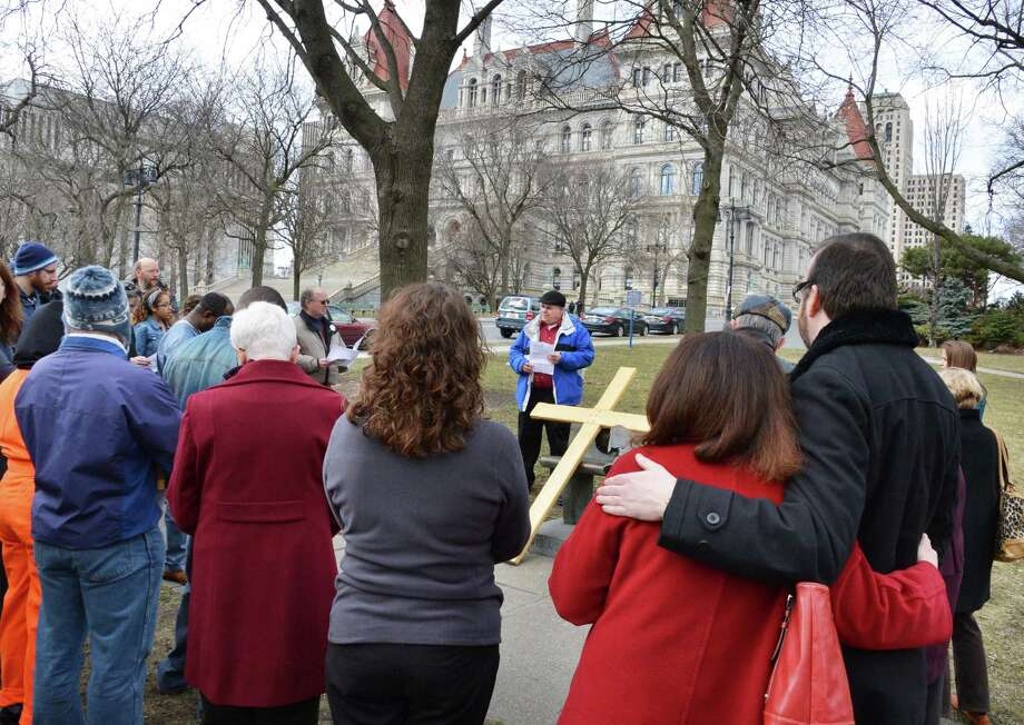 Local Christians pray for an end to suffering during Outdoor Stations of the Cross in Albany March 29, 2013.   (John Carl D'Annibale / Times Union) Photo: John Carl D'Annibale / 00021739A