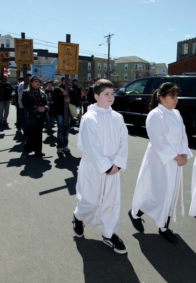 Parishioners and clergy from The Cathedral Parish fill the streets of Bridgeport during the Good Friday processional from St. Augustine's Cathedral to St. Patrick's Church in Bridgeport on Friday, Mar. 29, 2013. Photo: Amy Mortensen / Connecticut Post Freelance