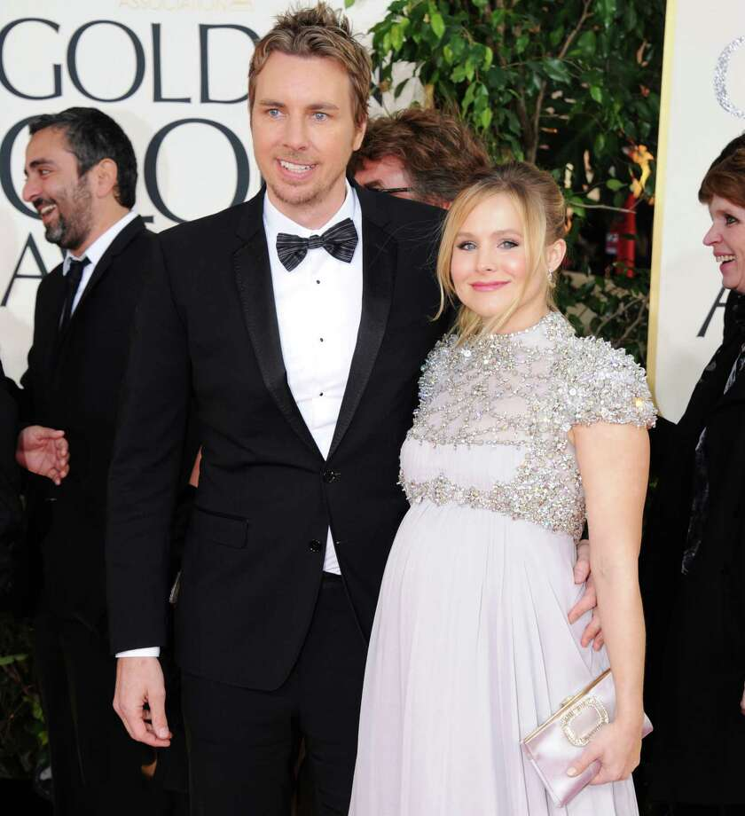 "FILE - In this Jan. 13, 2013 file photo, Kristen Bell and Dax Shepard arrive at the 70th Annual Golden Globe Awards at the Beverly Hilton Hotel in Beverly Hills, Calif. Bell tweeted Thursday, March 28, 2013, ""Welcome Baby Lincoln,"" confirming that she and fiance Shepard welcomed a new baby daughter.  (Photo by Jordan Strauss/Invision/AP, File) Photo: Jordan Strauss"
