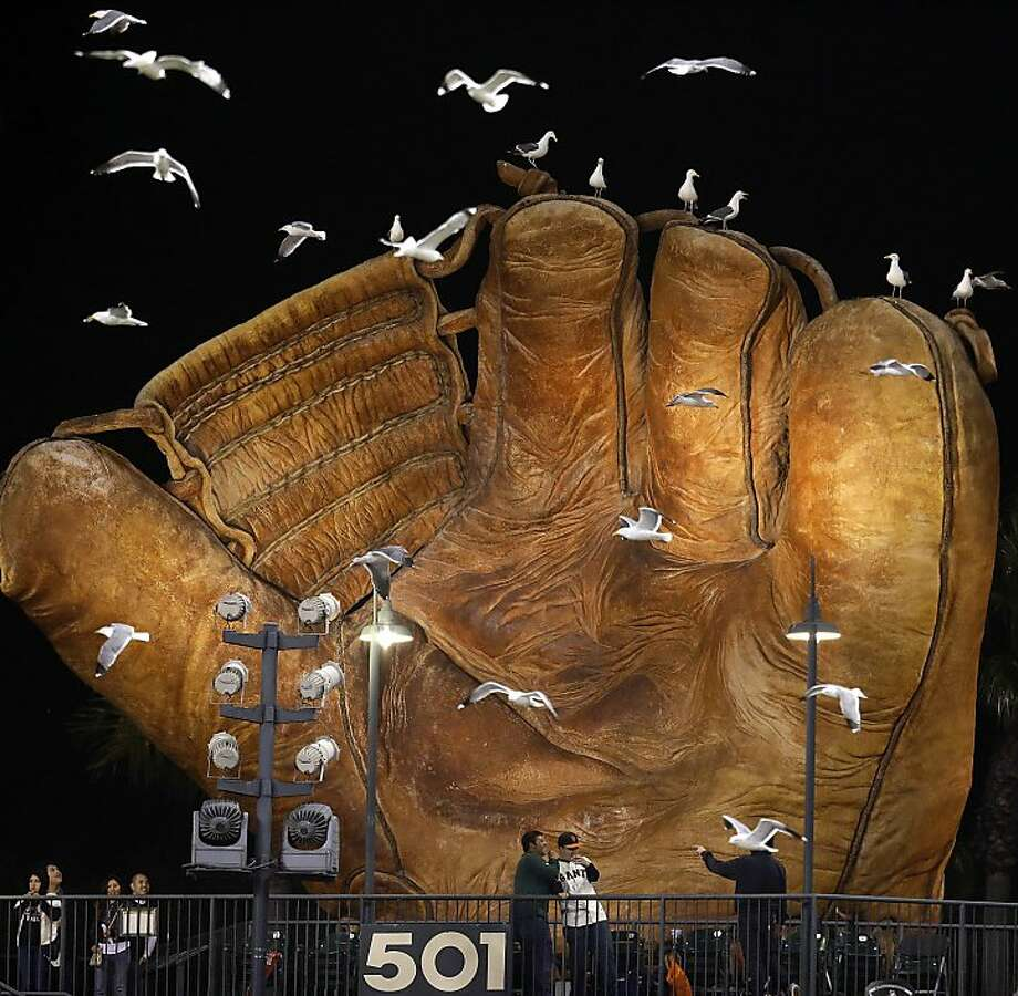 Heads up in the bleachers! Wonder how much the Giants spend cleaning seagull guano off the giant vintage glove in the left-field bleachers. Photo: Ben Margot, Associated Press