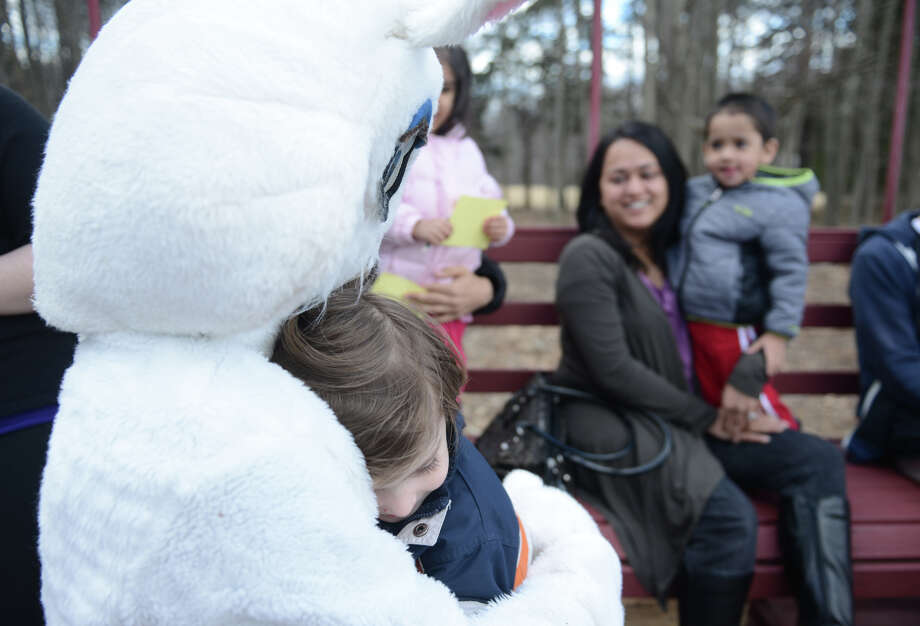 Brody Sauli, 4, of Newtown, gets a hug from the Easter Bunny on the Bunny Watch Hayride at Glander Field Pavilion in Newtown, Conn. on Friday, March 29, 2013.  Hundreds of people enjoyed the scenic hayride on antique tractors while counting the stuffed-animal bunnies hiding in the woods along the way. The Easter Bunny greeted the children halfway through the ride, giving hugs and handshakes.  Also available was a bounce house, slide, face painting and many other children's activities. Photo: Tyler Sizemore / The News-Times