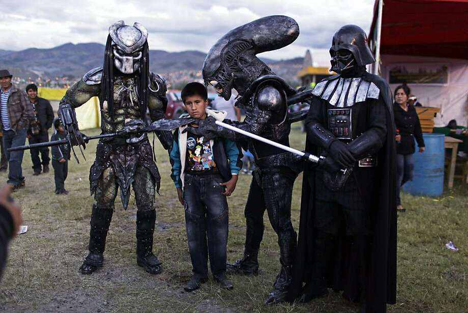 If Luke, Arnold and Ripley don't show up soon, I'm totally screwed:Famous sci-fi villains take a prisoner at the Canaan Fair, part of the Holy Week celebrations in Ayacucho, Peru. Photo: Rodrigo Abd, Associated Press