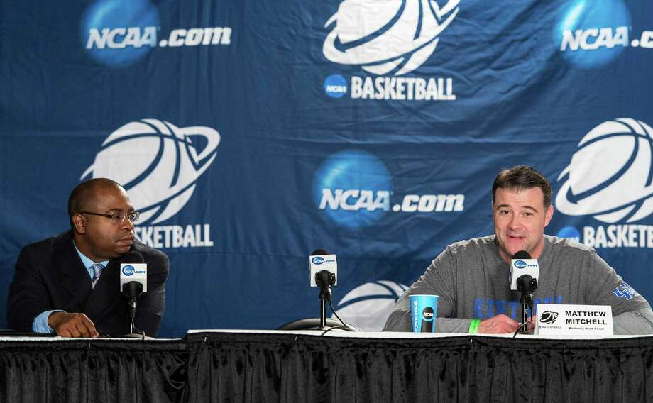 Kentucky women's basketball head coach, Matthew Mitchell (right), speaks to the media during a press conference at Webster Bank Arena in Bridgeport, Conn. on Friday, March 29, 2013. The Kentucky Wildcats will play the Delaware Blue Hens in the NCAA Bridgeport regional semifinals Saturday March 30th at noon. Scottie Rodgers, associate executive director communications and external relationsm The Ivy League moderates the press conference. Photo: Mark Conrad / Connecticut Post Freelance