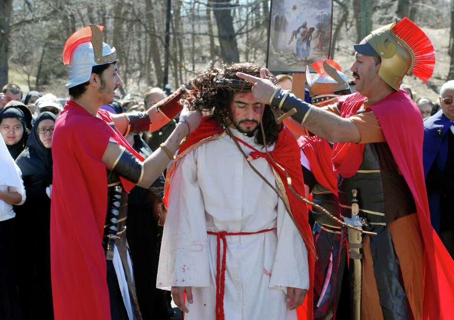 St. Benedict's/Our Lady of Montserat and St. Mary's parish join together in Stamford, Conn. on Friday March 29, 2013 to perform a live stations of the cross march from Cummings Park to St. Mary's. Amilar Oliva plays Jesus in the reenactment. Photo: Dru Nadler / Stamford Advocate Freelance