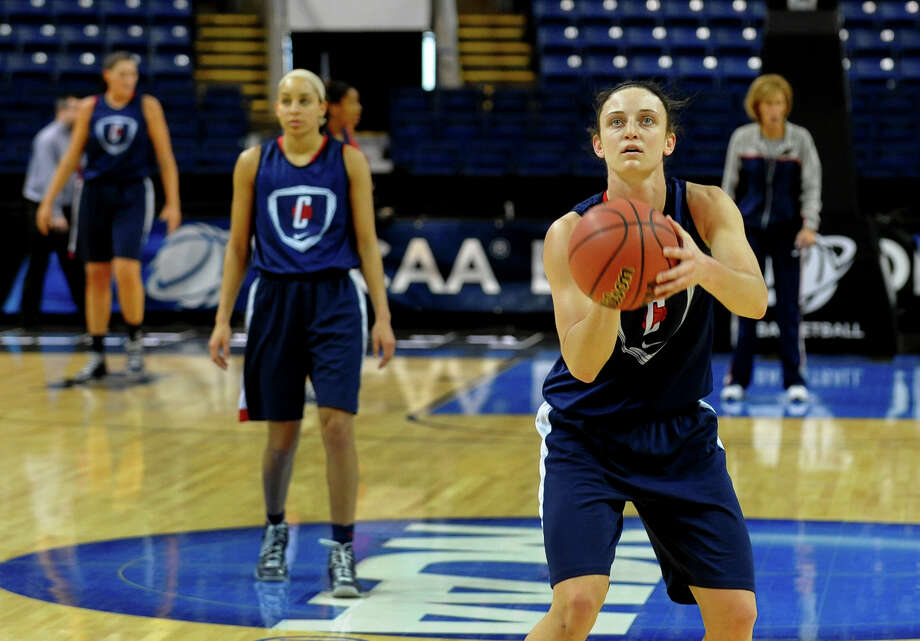 Kelly Faris at UConn women's team practice at the Webster Bank Arena in Bridgeport, Conn. on Friday March 29, 2013. In back behind Faris is Bria Hartley. The UConn Huskies will play the Maryland Terrapins in the NCAA Bridgeport Regional Semifinals on Saturday March 30th at 2:30. Photo: Christian Abraham / Connecticut Post