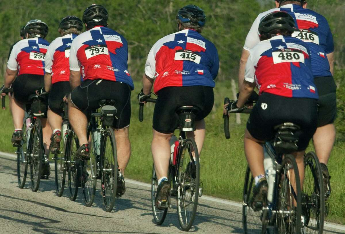 Members of the Lonestar Quick Print team participate in the 23rd annual Bluebonnet Express bike ride on Sunday March 25, 2012 in Waller, TX.