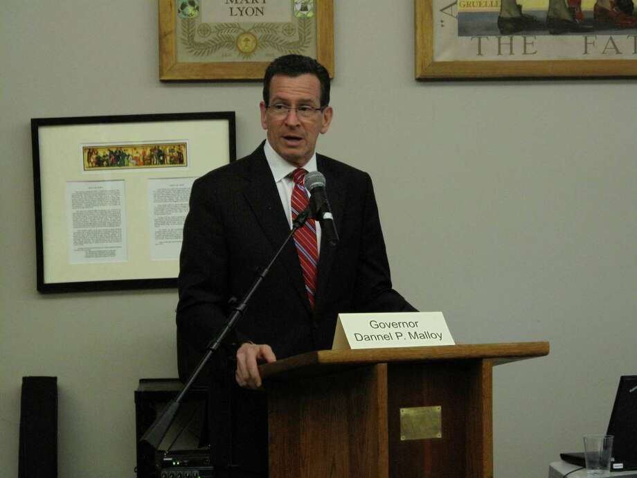 Governor Dannel Malloy spoke at the Energy and Infrastructure Solutions event at New Canaan High School Thursday night, March 28, 2013. He stressed the need for microgrids and the state's progress on energy innovation. Photo: Tyler Woods