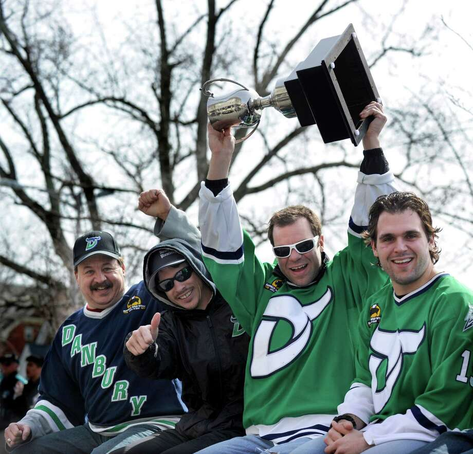 Team members celebrate the Danbury Whaler's championship  Commissionor's Cup win with a parade down Main Street in Danbury, Conn., Sunday, March 24, 2013. The celebration was combined with the city's  St. Partick's Day Parade. They are from, Russ Cole, Lynn Beedle, Kelly Miller and Matt Caranci. Photo: Carol Kaliff / The News-Times