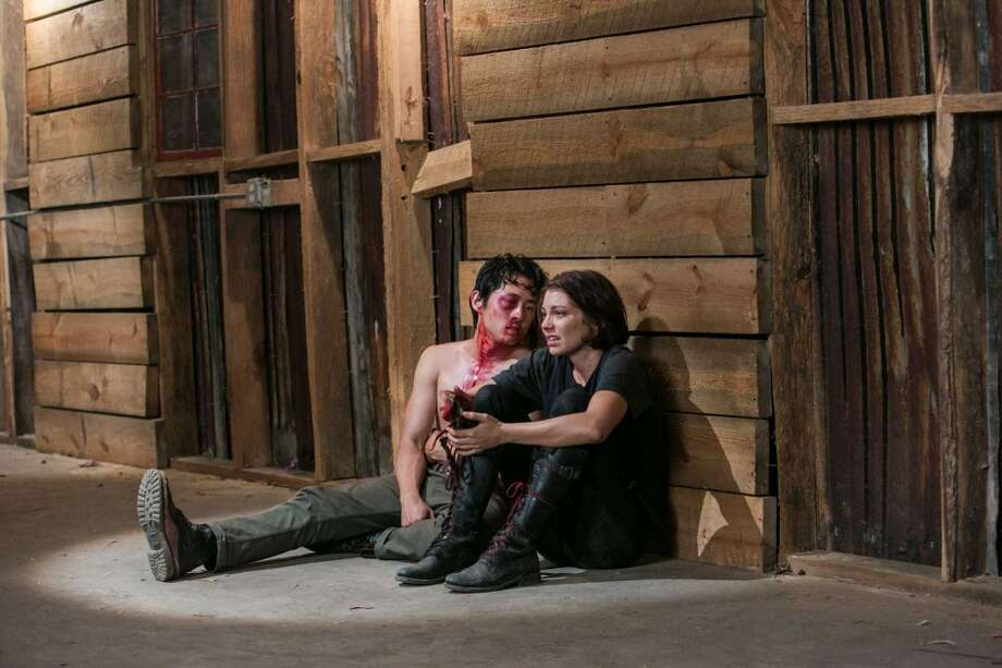 A beat-up-looking Glenn (Steven Yeun) and Maggie (Lauren Cohan) in Season 3.