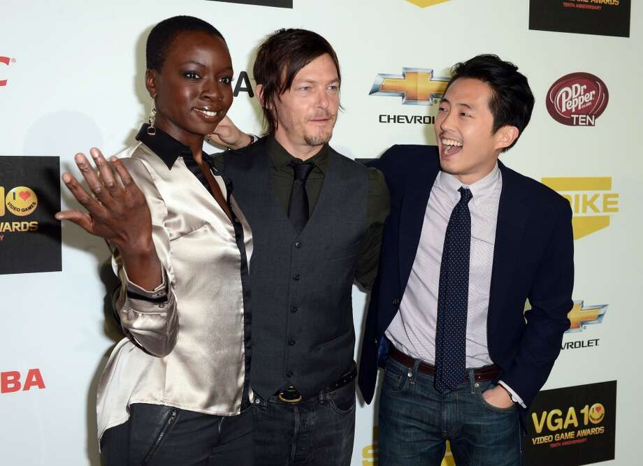 Danai Gurira (left), Norman Reedus (center) and Steven Yeun arrive at Spike TV's Video Game Awards on Dec. 7, 2012.