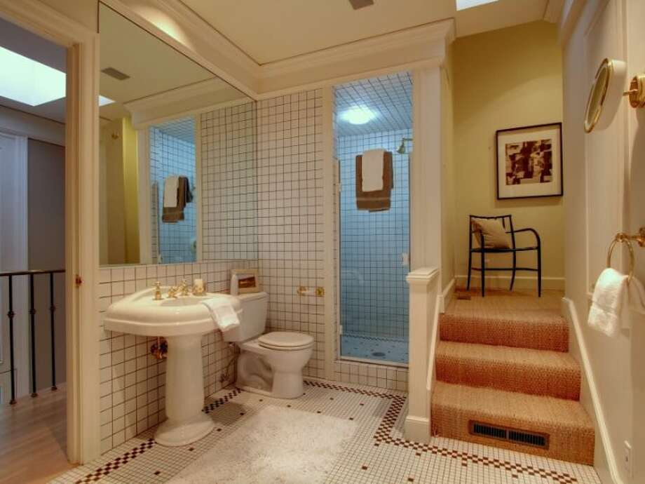 Bathroom of 11 Comstock St. The 4,190-square-foot house, built in 1991, has four bedrooms, 3.5 bathrooms, a two-story entry, marble floors, walls of windows, a wood-paneled library, decks, a patio, city and water views, and a two-car garage on a 5,197-square-foot lot. It's listed for $1.799 million. Photo: Courtesy Colleen McCann/Windermere Real Estate