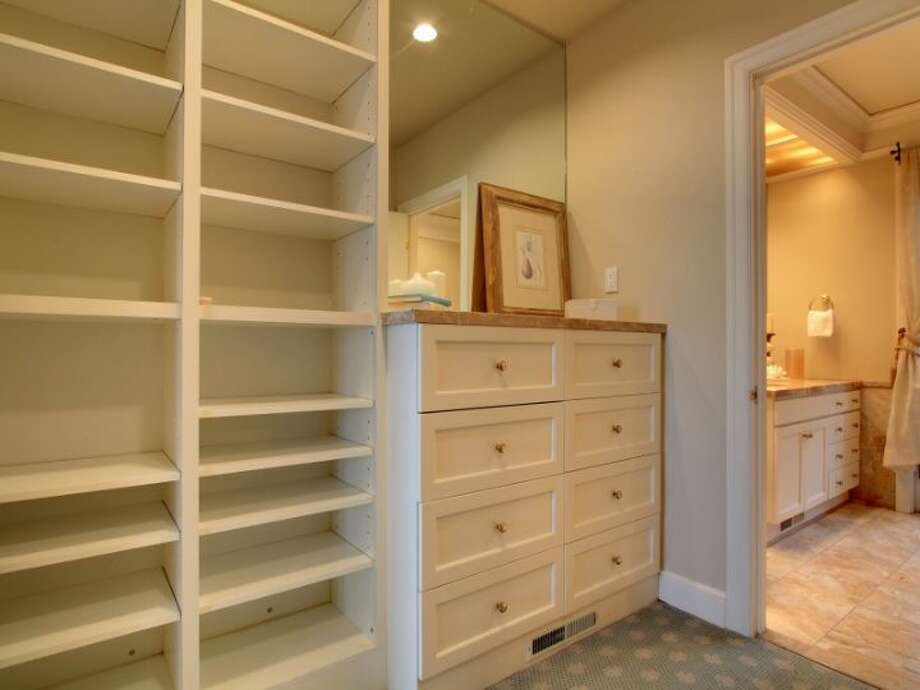 Master bedroom closet of 11 Comstock St. The 4,190-square-foot house, built in 1991, has four bedrooms, 3.5 bathrooms, a two-story entry, marble floors, walls of windows, a wood-paneled library, decks, a patio, city and water views, and a two-car garage on a 5,197-square-foot lot. It's listed for $1.799 million. Photo: Courtesy Colleen McCann/Windermere Real Estate