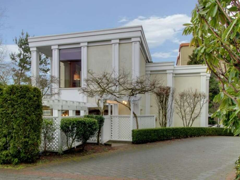 Noted Seattle architect Ralph Anderson designed this modern home in Queen Anne, at 11 Comstock St. The 4,190-square-foot house, built in 1991, has four bedrooms, 3.5 bathrooms, a two-story entry, marble floors, walls of windows, a wood-paneled library, decks, a patio, city and water views, and a two-car garage on a 5,197-square-foot lot. It's listed for $1.799 million. Photo: Courtesy Colleen McCann/Windermere Real Estate