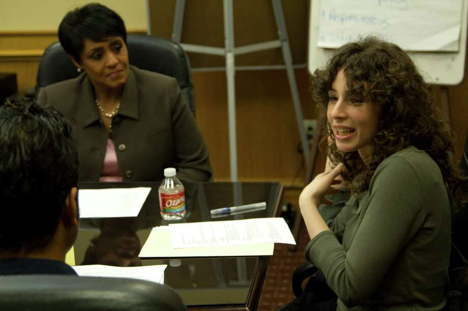 """Artist Liz Magic Laser, right, discusses her performance-art project with former KPRC-TV news anchor Linda Lorelle, left, and other collaborators during a meeting in February. The group will stage """"Tell Me What You Want to Hear"""" for DiverseWorks starting Friday. Photo: Jack J. Valenti School Of Commun"""