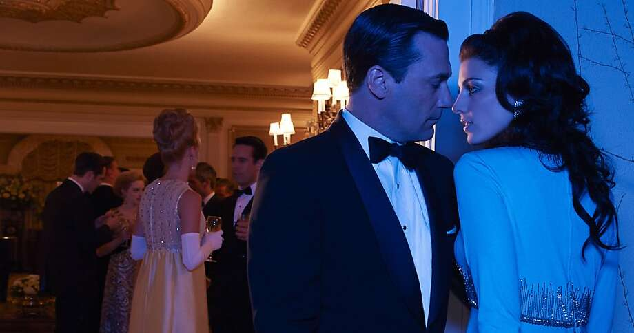 "Don Draper (Jon Hamm) and Megan Draper (Jessica Paré) get close as ""Mad Men"" starts its sixth season Sunday on AMC. Photo: Frank Ockenfels, AMC"