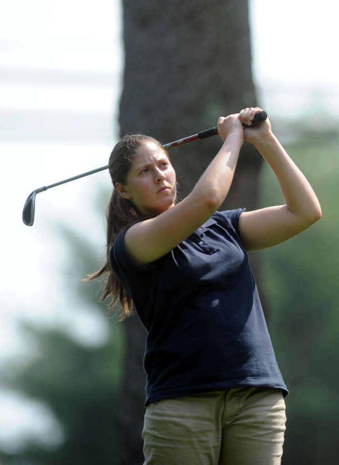 Staples' Erica Stein tees off on the second hole during a golf meet against Greenwich Wednesday, May 16, 2012 at Longshore Golf Course in Westport, Conn. Photo: Autumn Driscoll / Connecticut Post