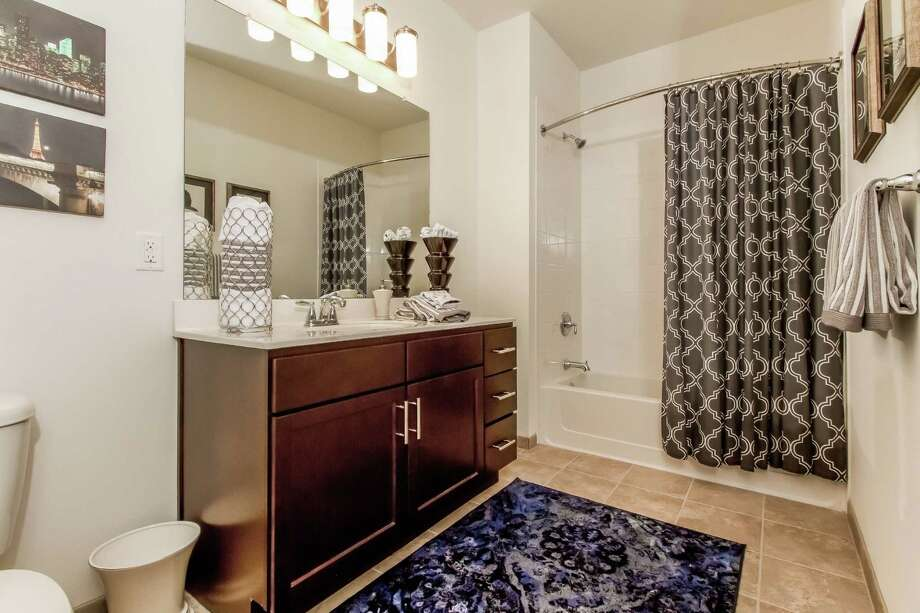 A bathroom in one of the new apartments at Abbey Woods, a luxury residential community that recently opened in Danbury. Photo: Contributed Photo