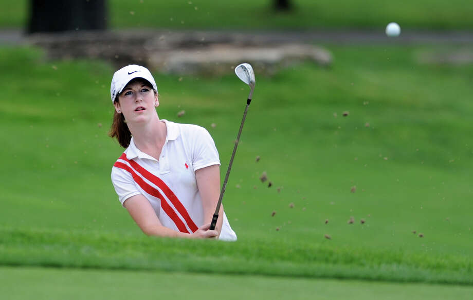Mary Bennewitz, of Westport, hits her ball out of a bunker during the Borck Memorial Golf Tournament Wednesday, August 1, 2012 at Mill River Country Club in Stratford, Conn. Photo: Autumn Driscoll / Connecticut Post