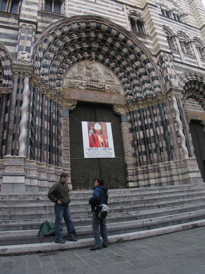 Exterior of Cattedrale di San Lorenzo (San Lorenzo Cathedral) in Genoa. (Photo from 2006; note sign on door from a couple popes ago.) Photo: Spud Hilton, SFC / The Chronicle