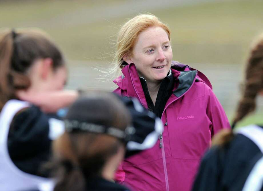 New Canaan High School girls lacrosse coach Kristin Woods during the girls high school lacrosse scrimmage between Convent of the Sacred Heart and New Canaan High School at Convent in Greenwich, Tuesday, March 26, 2013. Photo: Bob Luckey / Greenwich Time