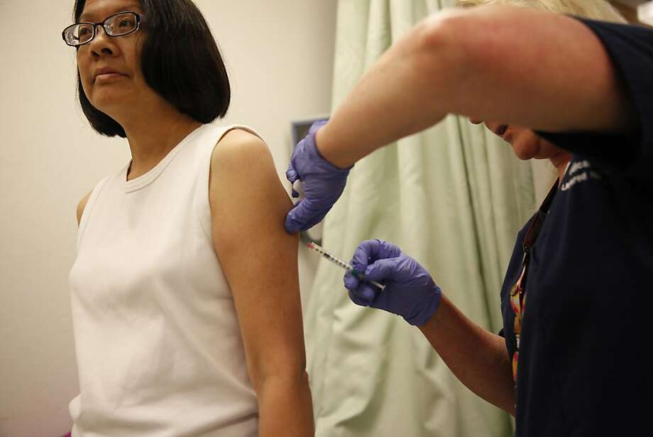 Amy Yee of Hercules receives an allergy shot from nurse Glenna Mote at the UCSF Allergy and Immunology Faculty Practice. Photo: Lea Suzuki, The Chronicle