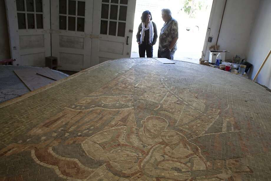 Jantine Neuwirth (above left) and George Cagwin confer about the mosaic murals under restoration. Photo: Sam Wolson, SFC