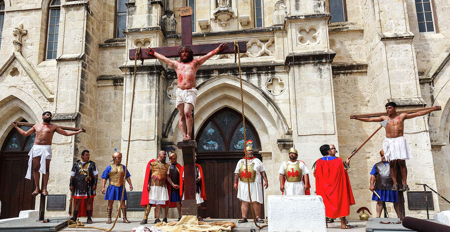 Jesus, Played by John Austin, is crucified with two thieves, played by Jacob Holguin and George Estrada, during the annual re-enactment of the Passion of the Christ in front of San Ferdando Cathedral on Friday, March 29, 2013.  MARVIN PFEIFFER/ mpfeiffer@express-news.net Photo: MARVIN PFEIFFER, Marvin Pfeiffer/ Express-News / Express-News 2013