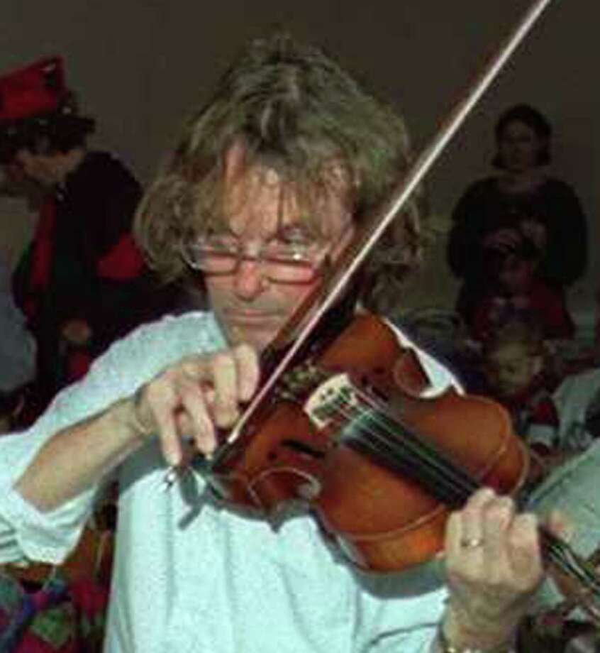 Michael Shrdlu Ashe plays the Violin in this undated file photo. Photo: File Photo/ Doug Healey, File Photo / The News-Times File Photo