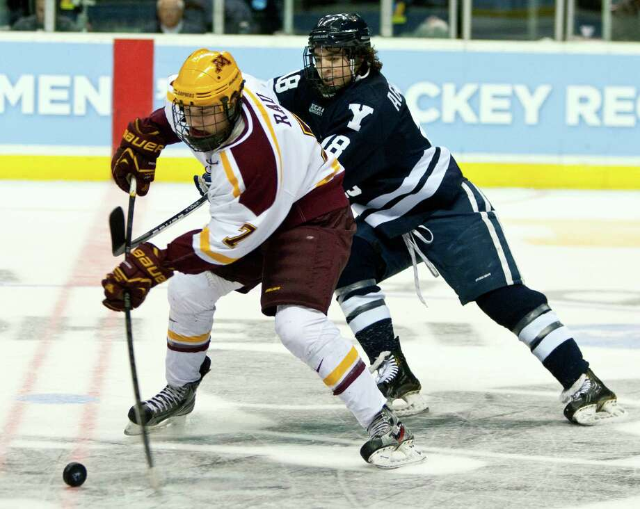 Minnesota's Kyle Rau, left, skates against Yale's Kenny Agostino in the first period of the NCAA Division I Hockey college regional tournament game in Grand Rapids, Mich., Friday, March 29, 2013.  ALL LOCAL TV OUT; LOCAL TV INTERNET OUT. Photo: The Grand Rapids Press, Cory Morse